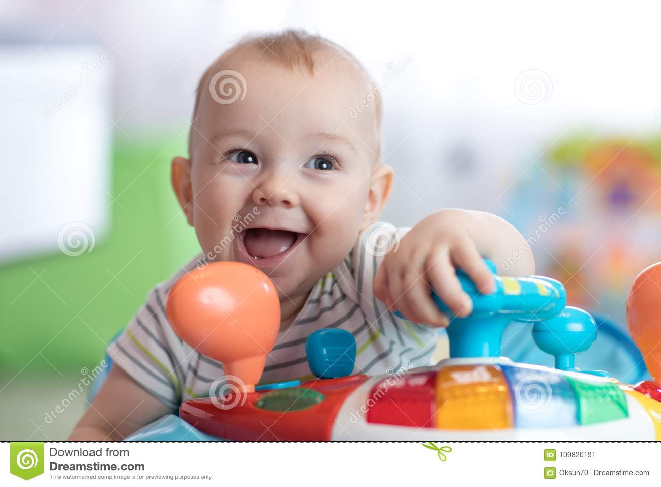1424cbbd3 Funny Baby Playing In Baby Jumper Stock Image - Image of cheerful ...