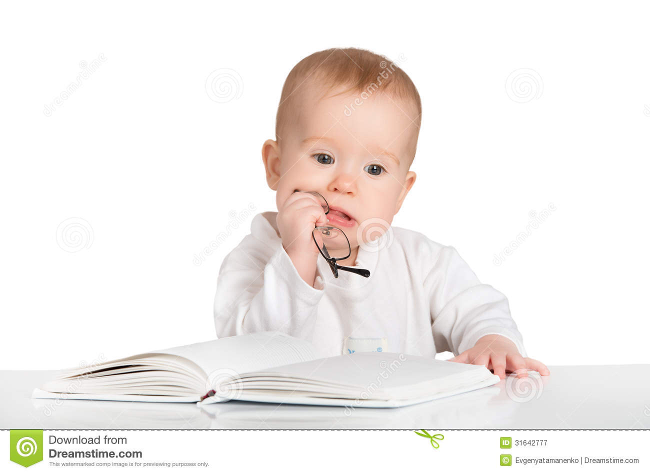 Funny baby reading a b...