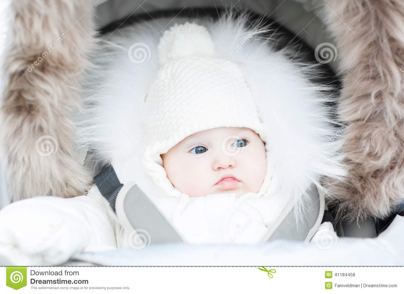Funny Baby In A Warm Stroller On A Cold Winter Day Stock