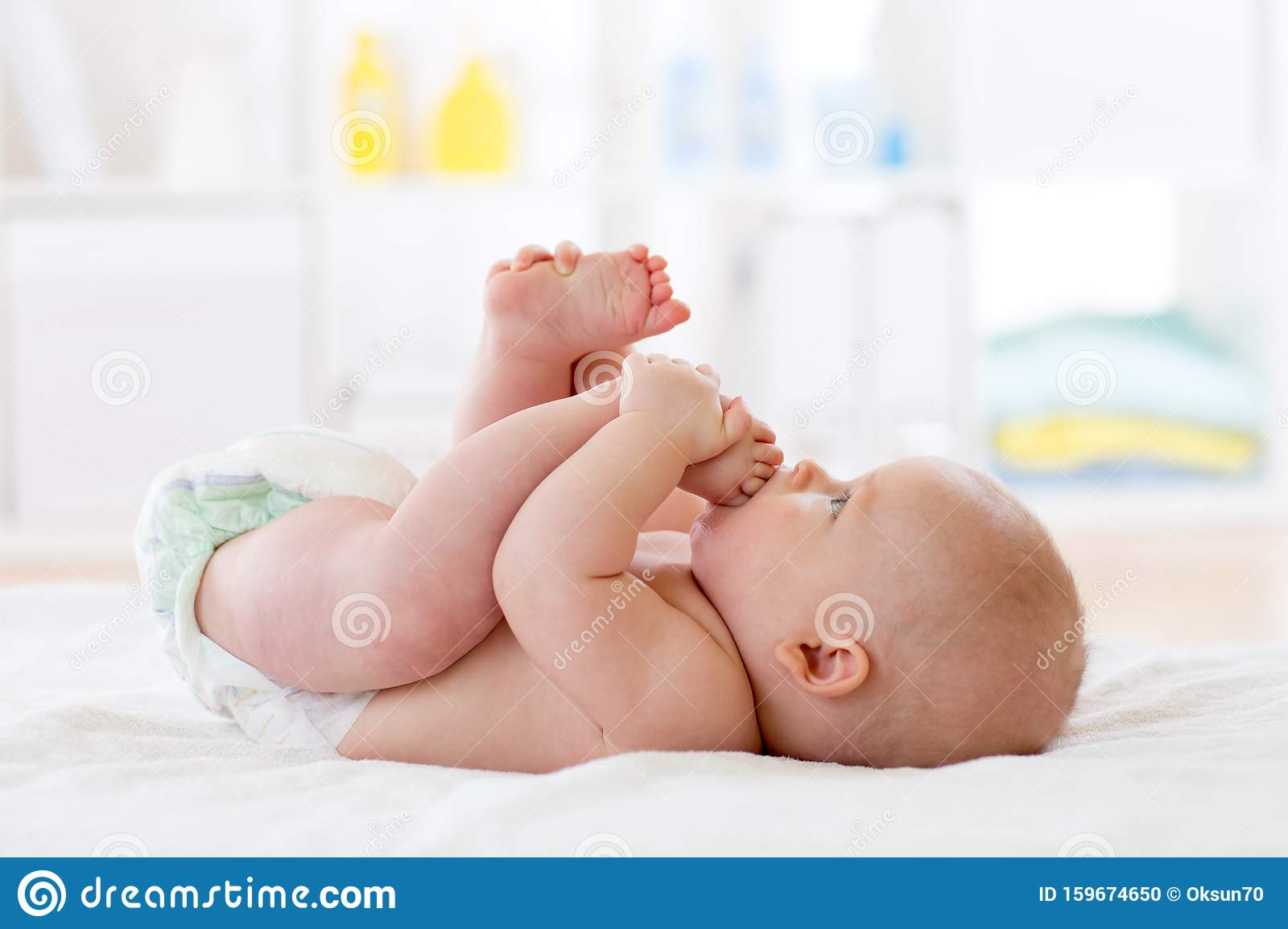 Funny Baby Wearing Diaper Infant Kid Skin Care Cute Child Playing With His Feet Stock Photo Image Of Feet Cute 159674650