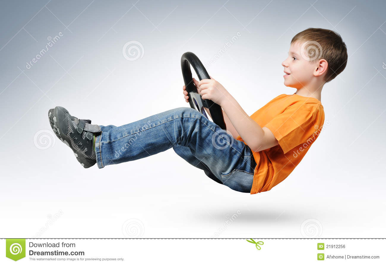 Funny Boy Car Driver With The Steering Wheel Royalty Free Stock Image