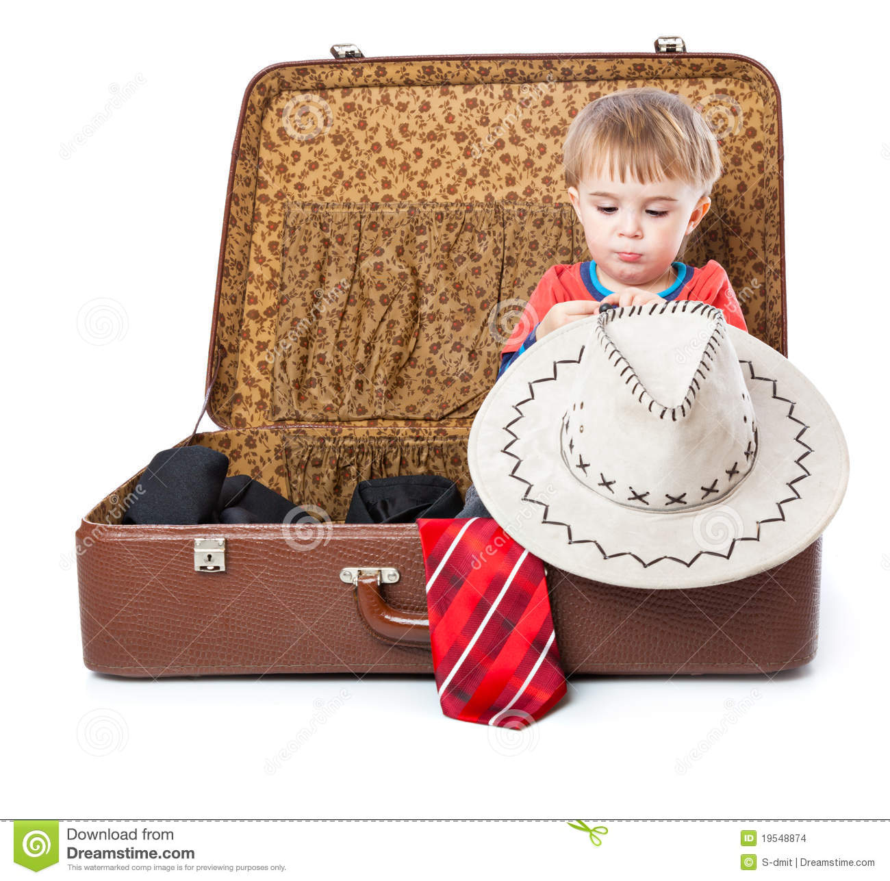A Funny Boy With Sombrero Is In The Suitcase Stock Images