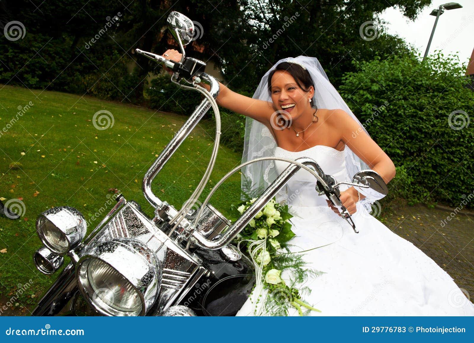 Harley Davidson Wedding: Bride On Harley Davidson Bike Stock Image