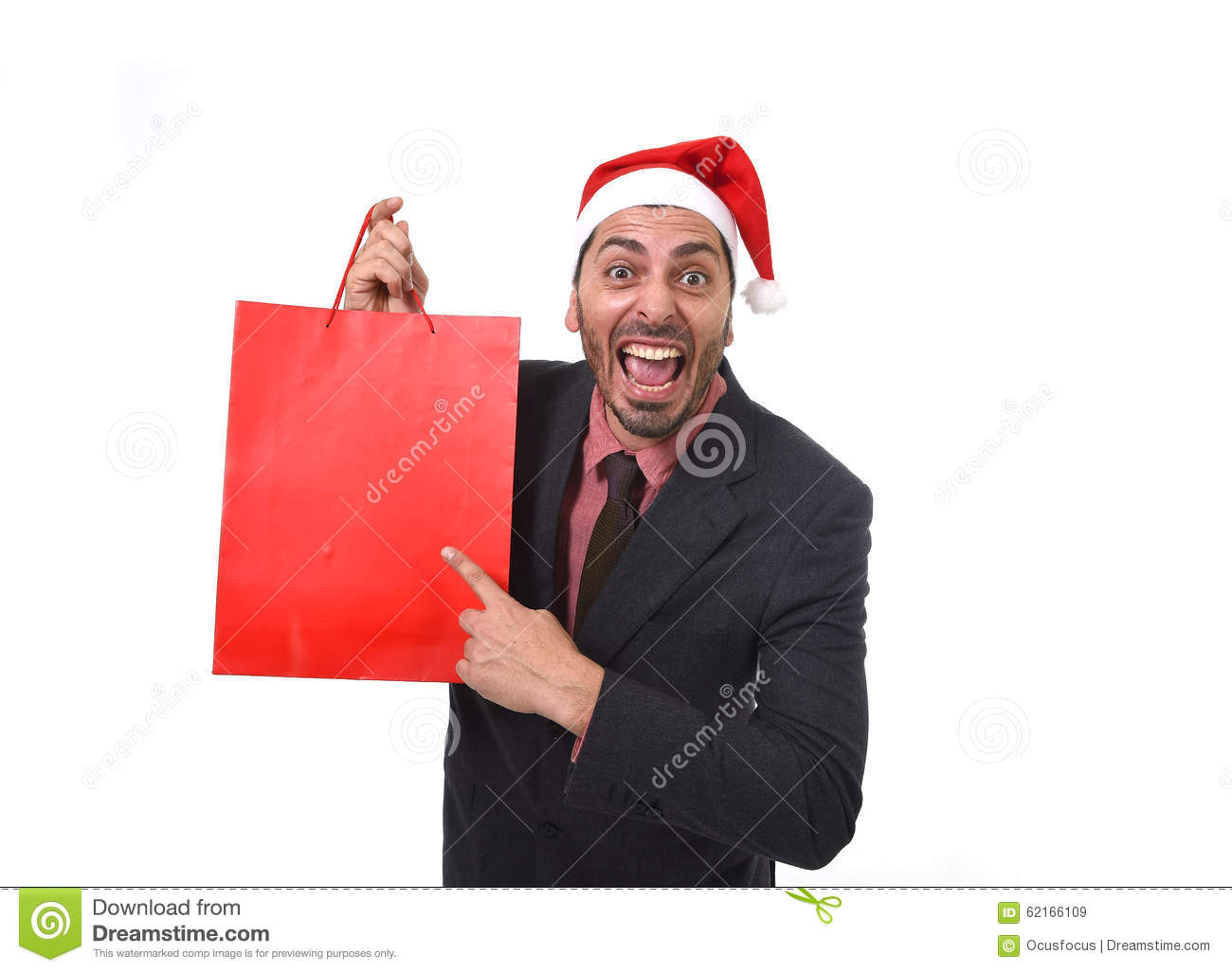 Funny businessman in christmas santa hat holding red