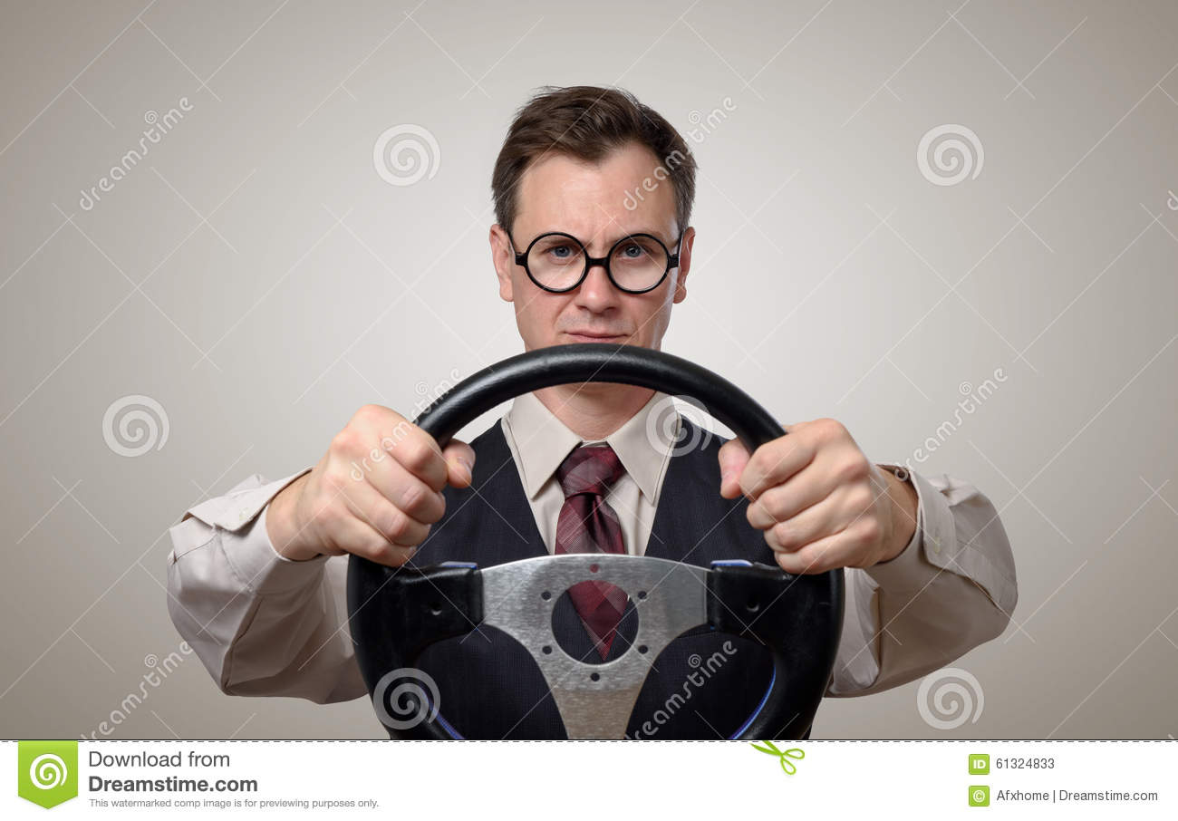 Funny businessman in glasses with a steering wheel