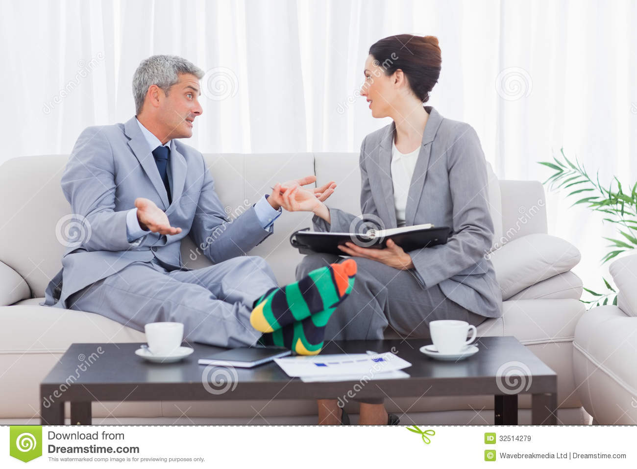 Funny Businessman Wearing Stripey Socks And Talking With His Col ...
