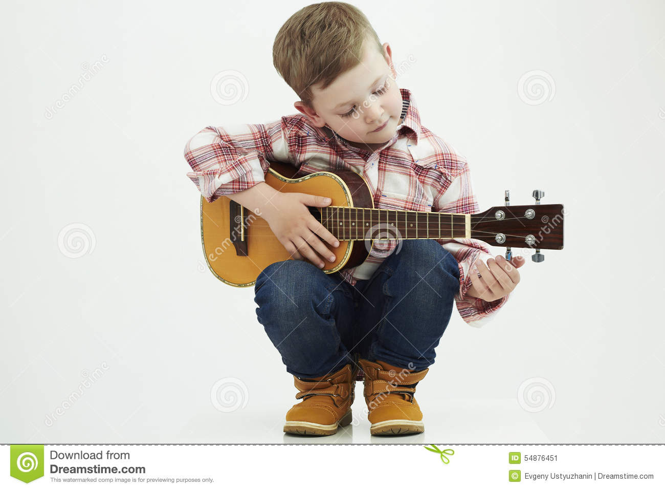 Funny child boy with guitar. country boy playing music