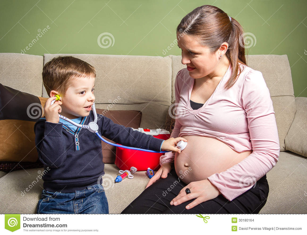 Child Doctor Examining His Pregnant Mother Stock