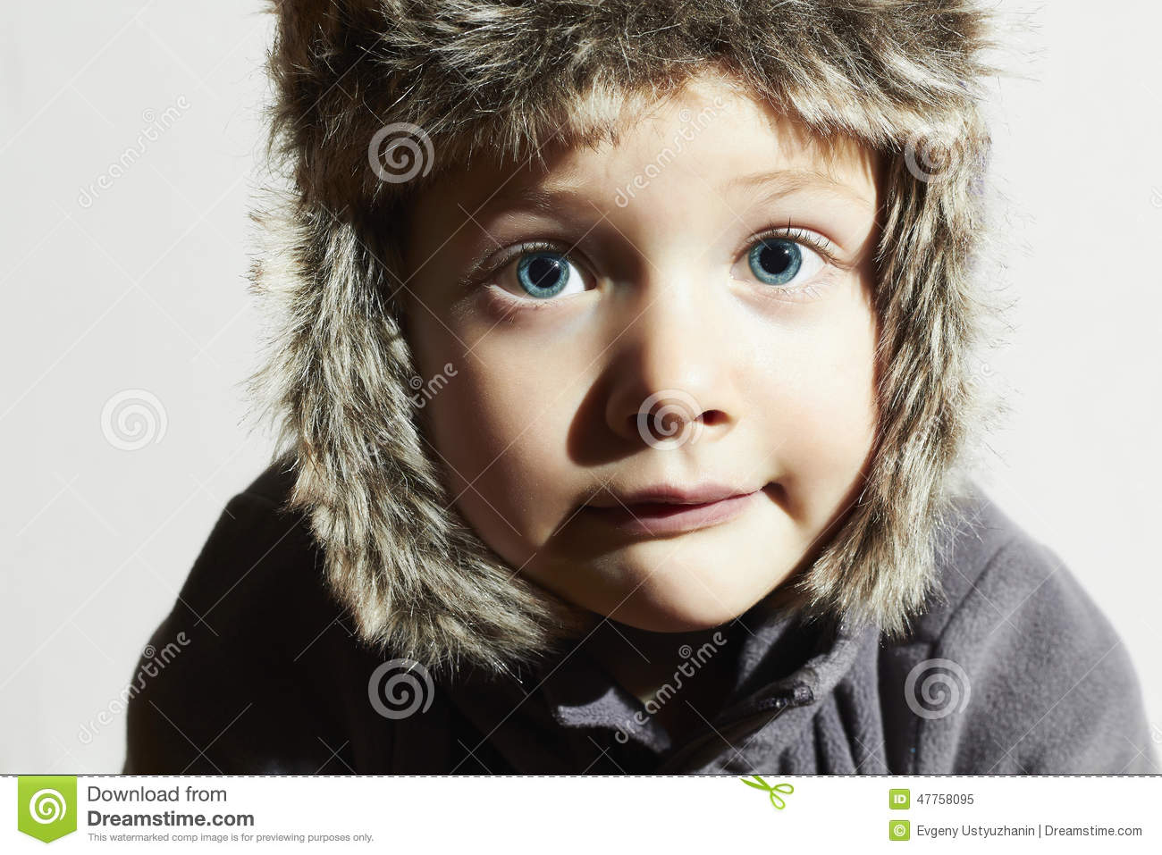 7534f4b27697 Funny Child In Fur Hat.casual Winter Style.Big Blue Eyes Stock Image ...