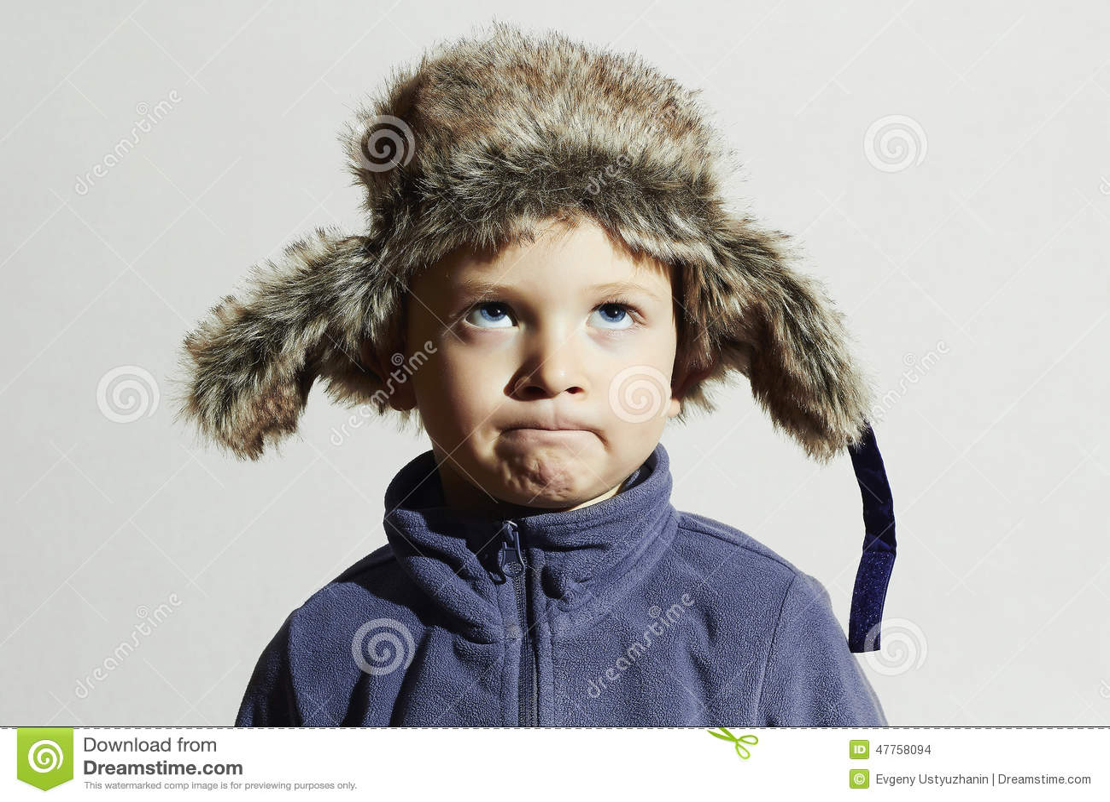 4efda0fb7970 Funny Child In Fur Hat.fashion Casual Winter Style.little Boy Stock ...