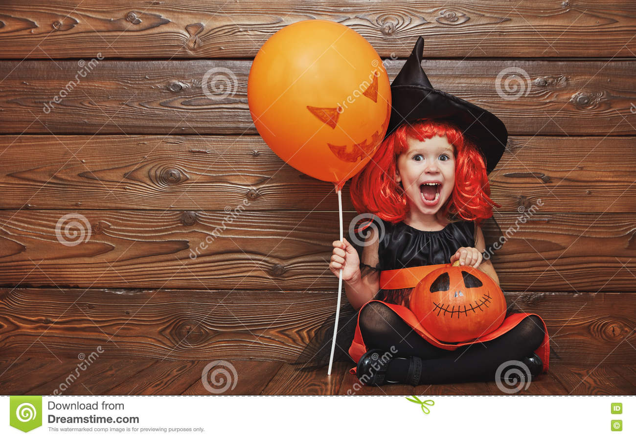 Funny Child Girl In Witch Costume For Halloween With Pumpkin Ja ...