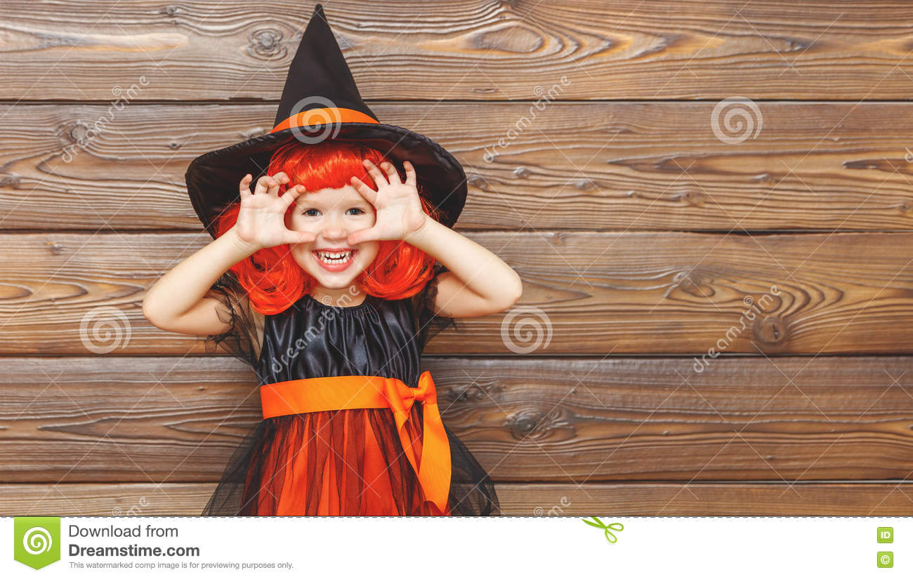 Funny Child Girl In Witch Costume For Halloween Scares Stock Photo ...