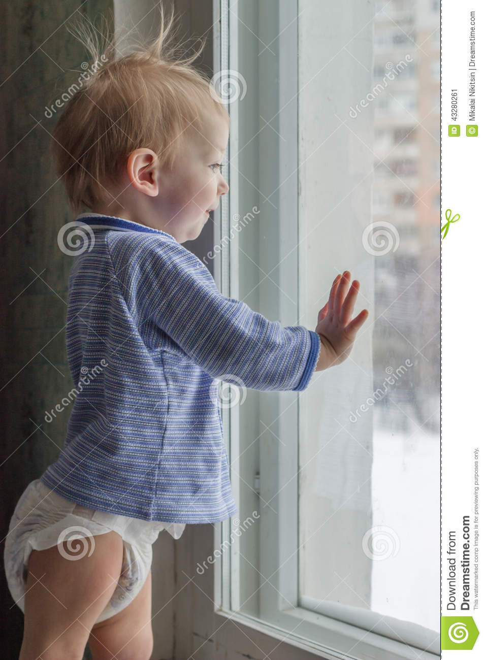 Funny Child Looks Out Of The Window Stock Photo Image