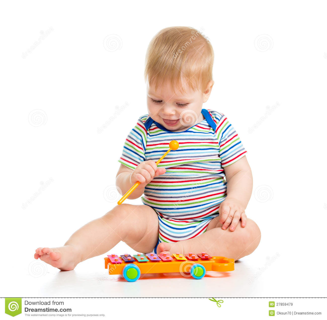 Musical Toys For Toddlers Boys : Funny child playing with musical toys royalty free stock