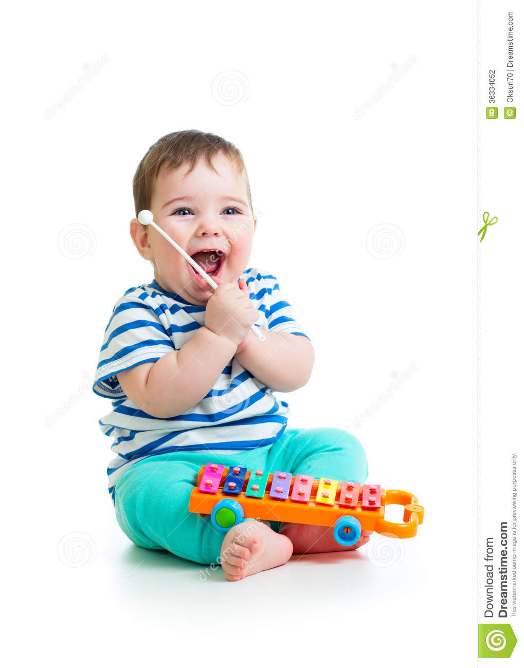 Musical Toys For Toddlers Boys : Funny child playing with musical toys stock photography