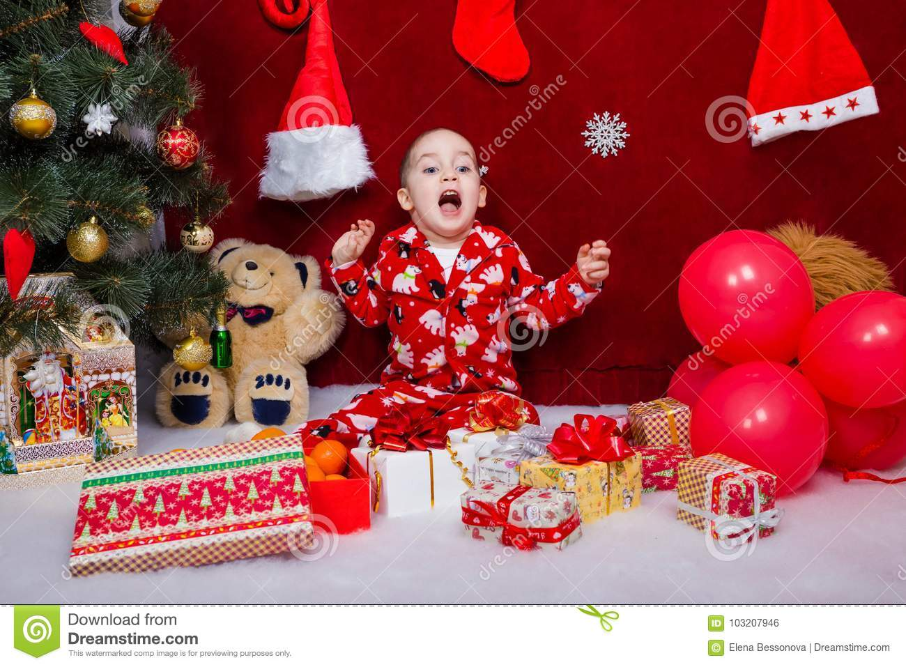 Funny Child Was Delighted With The Number Of Christmas Gifts Stock ...