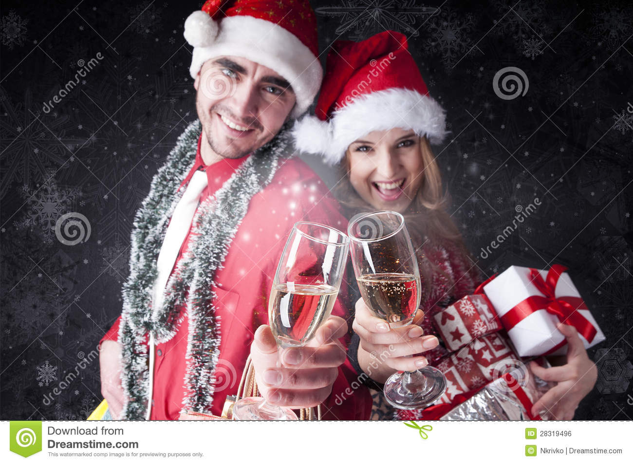 Download Funny Christmas Couple With Glasses Of Champagne Stock Photo