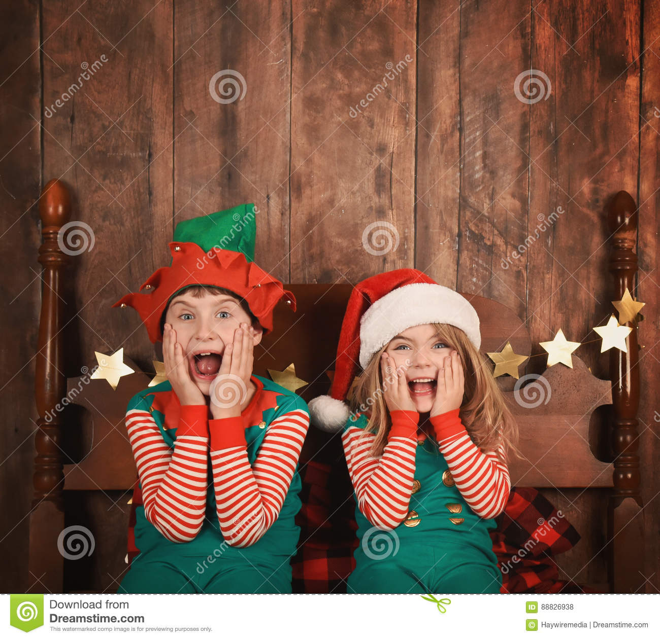Funny Christmas Kids on Bed with Hats