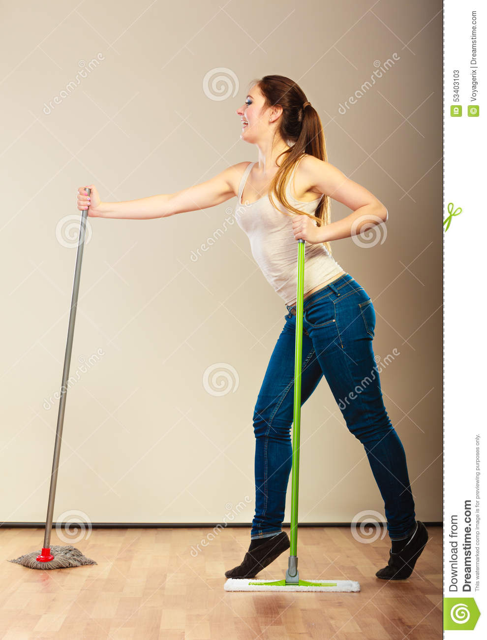 Funny Cleaning Woman Mopping Floor Dancing Stock Photo