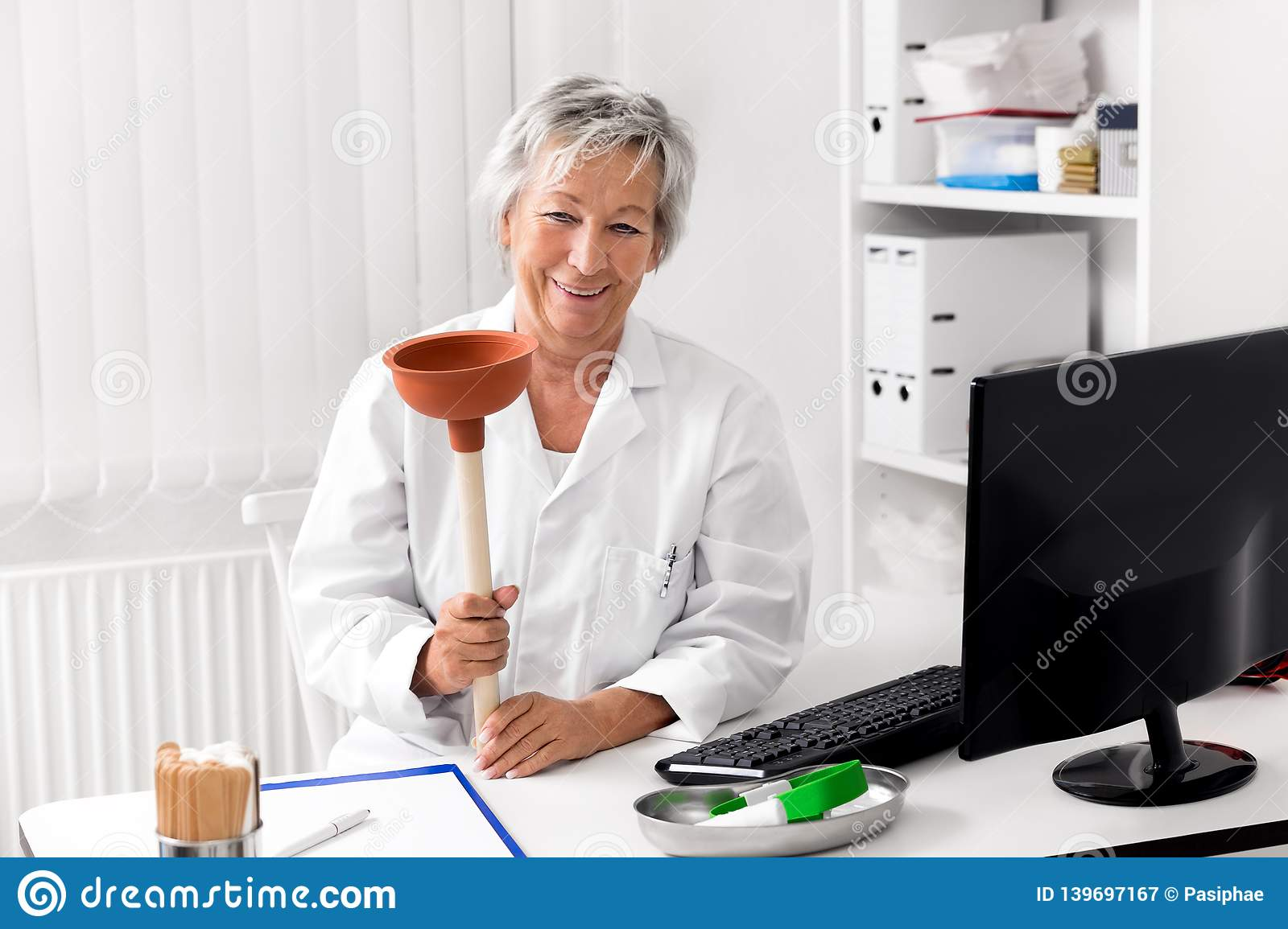 Funny Concept For Diarrhea Or Constipation Female Doctor With A Plunger Stock Image Image Of Health Healthcare 139697167