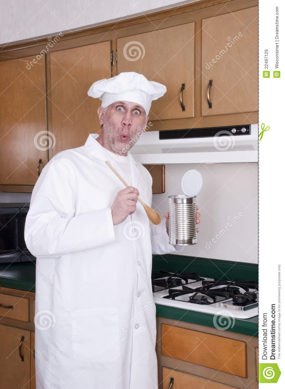 Funny Cook Chef Cooking Out Of Can On Stove Stock Image