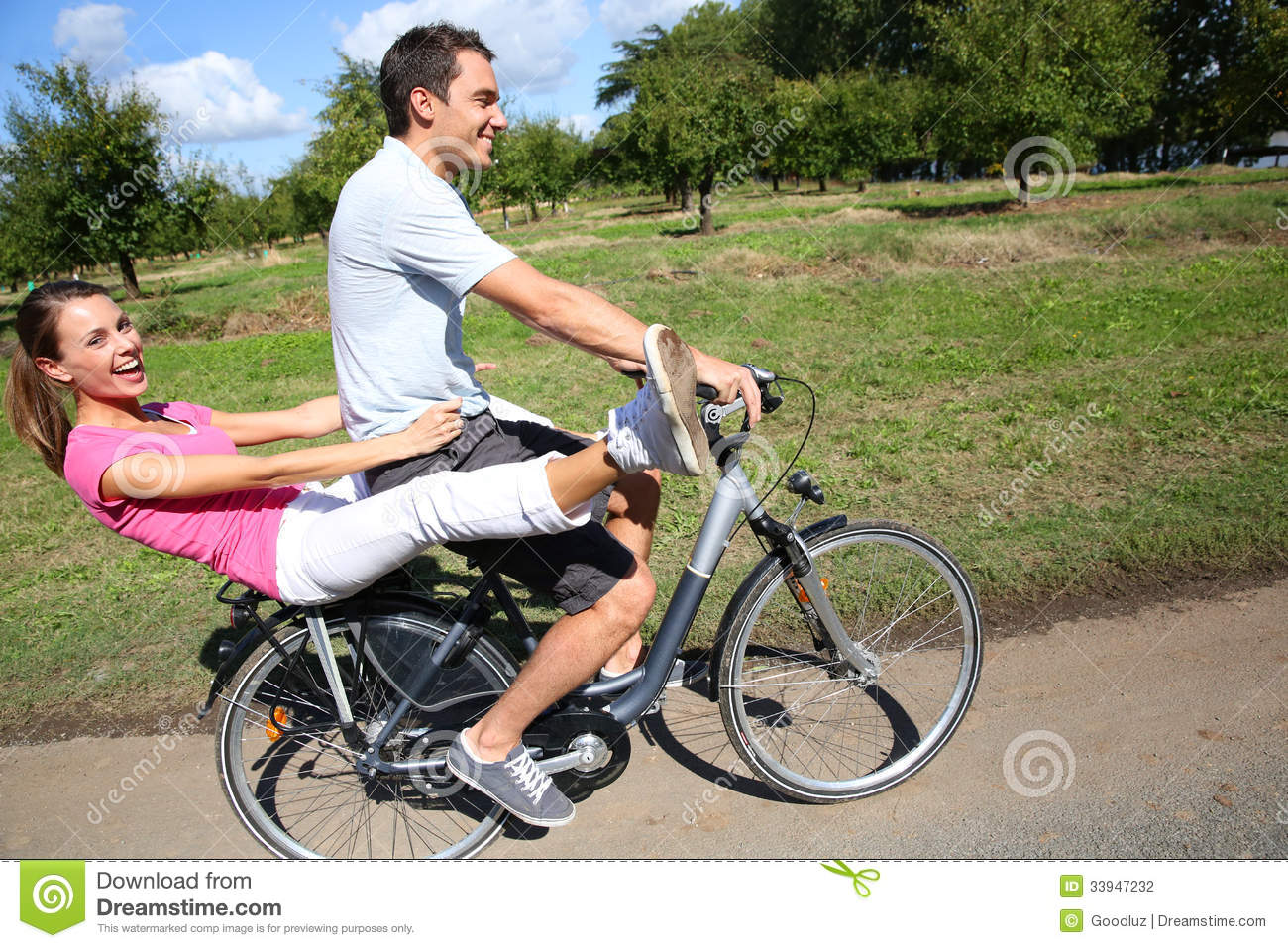 Funny Couple Riding On Bicycle Stock Photography - Image ...