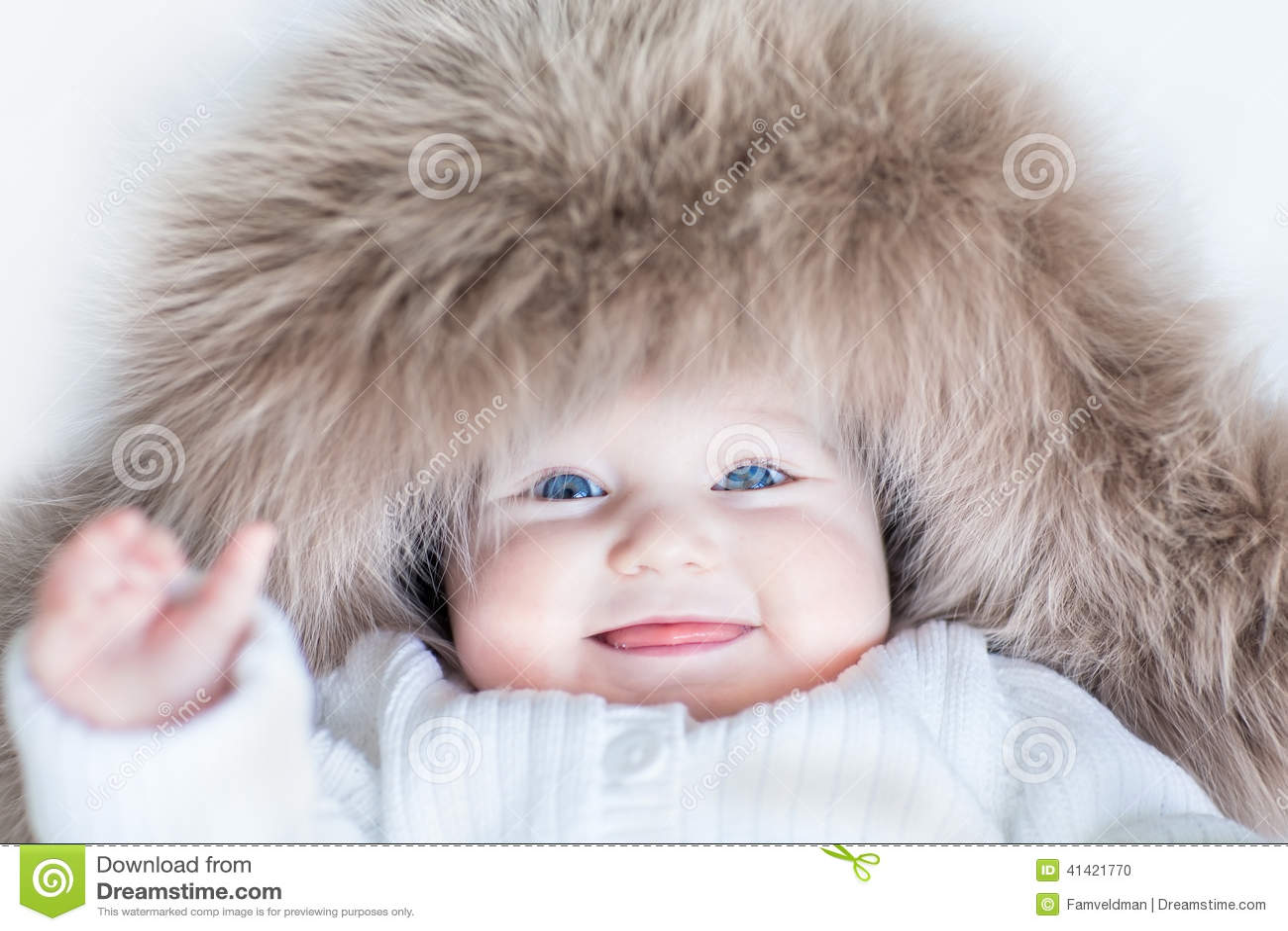 funny cute baby girl wearing huge winter hat stock photo