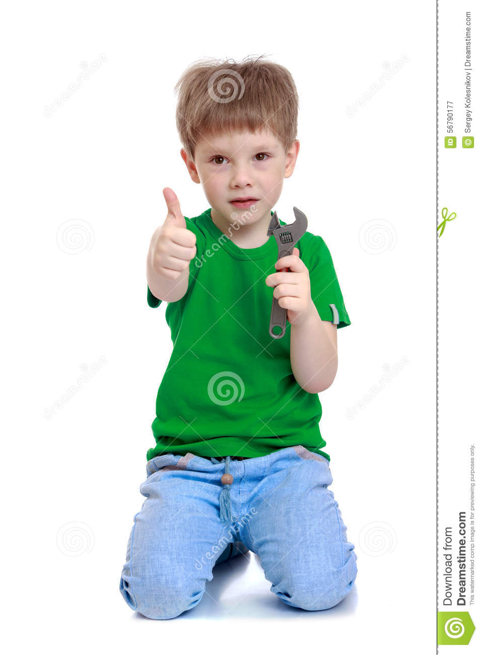funny cute little boy in a green tshirt and jeans stock