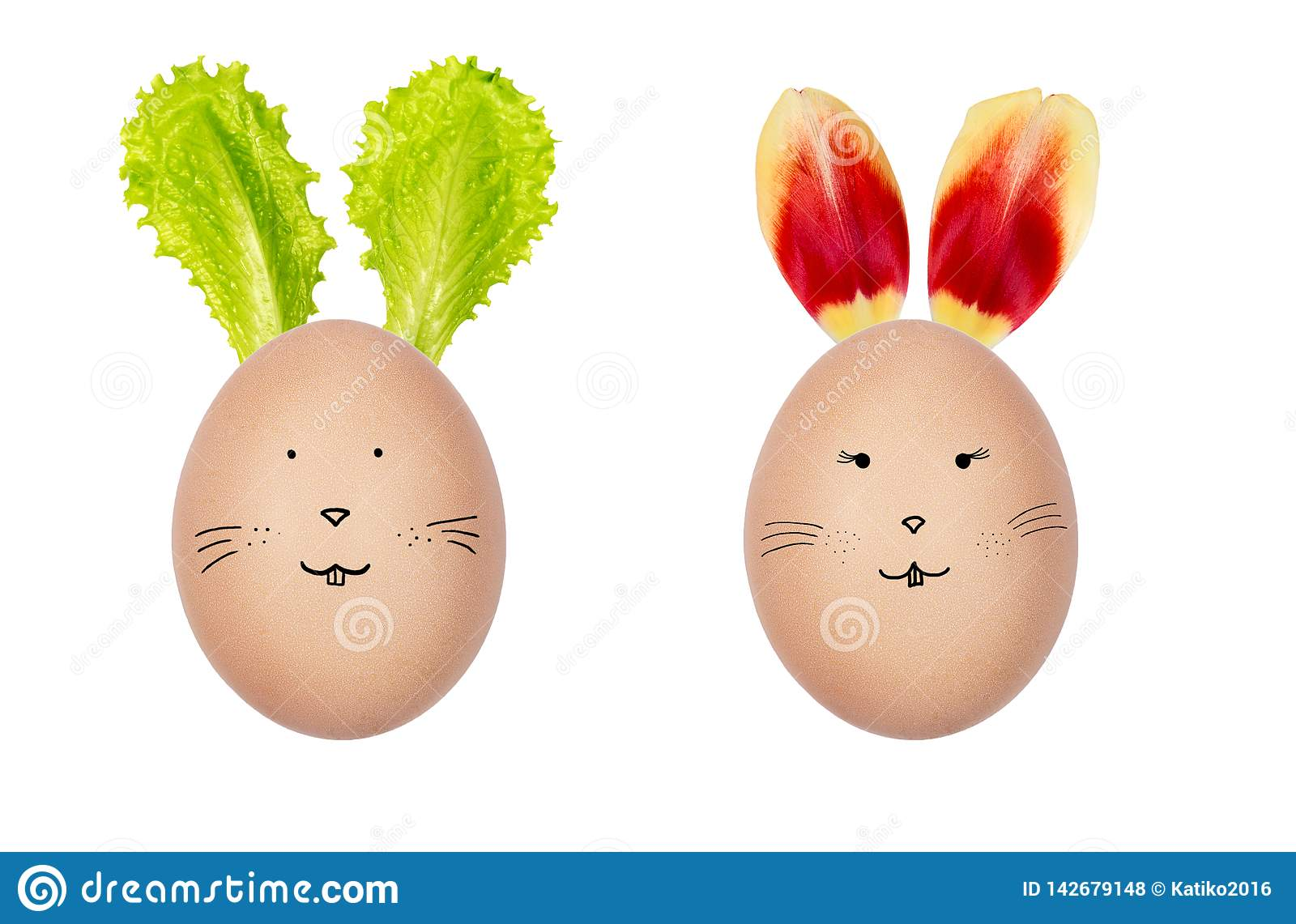 Funny Easter eggs decorated with fresh salad leaves and tulip petals. Bunny faces drawn on the eggs. Creative Easter decoration.