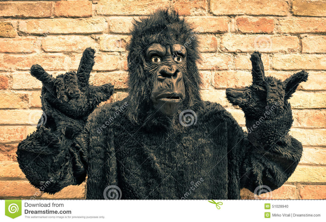 funny fake gorilla with rock and roll hand gesture stock