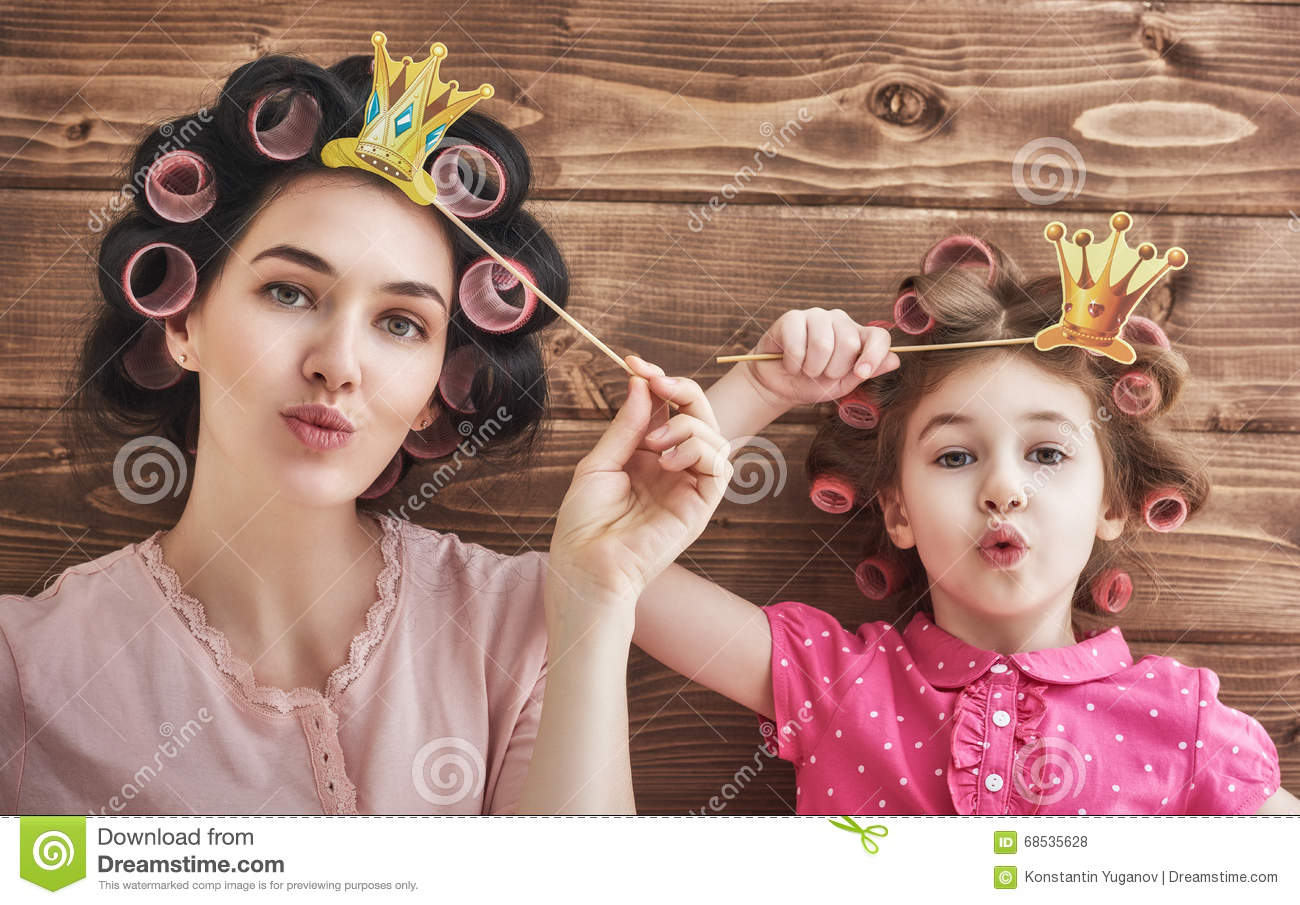 Beautiful Girl Holding Fashion Beauty Magazine Stock Image: Funny Family With A Paper Accessories Stock Photo