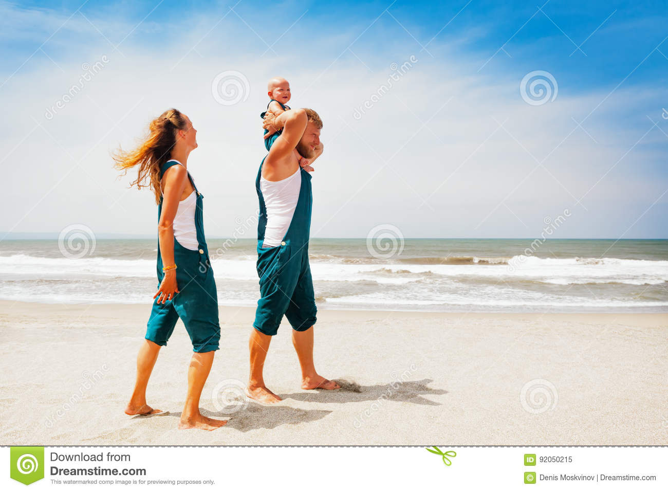 Funny Family Walking On The Sea Beach