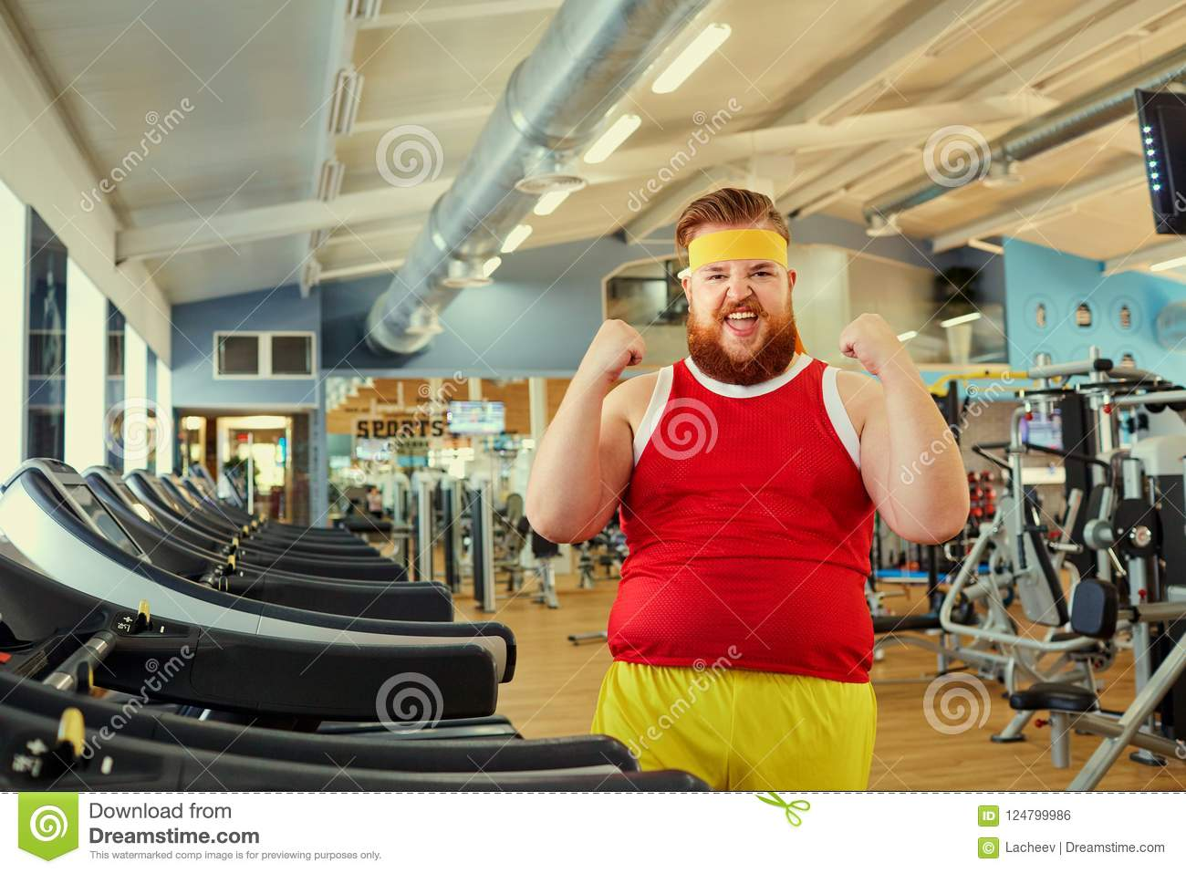 A Funny Fat Man Doing Exercises In The Gym Stock Photo Image Of Comic Smile 124799986