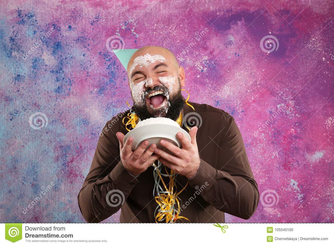 Funny fat man eating birthday cake and smearing cream