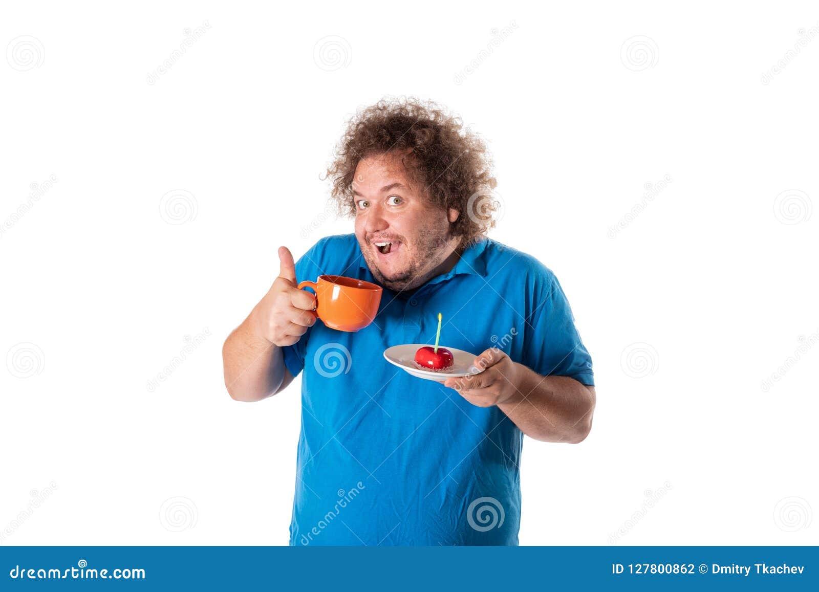Funny fat man with mug and cake. Happy birthday