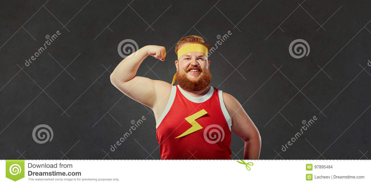 Funny fat man in sports clothes shows a hand with muscles biceps