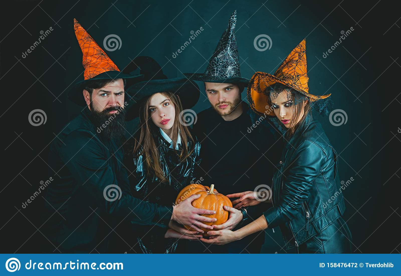 Funny friends at a Halloween party. Happy Halloween. Halloween group. Enjoying nice Halloween together.