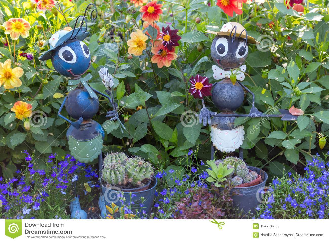 Backyard Statues funny garden figures in grass and flowers. backyard decor. ants