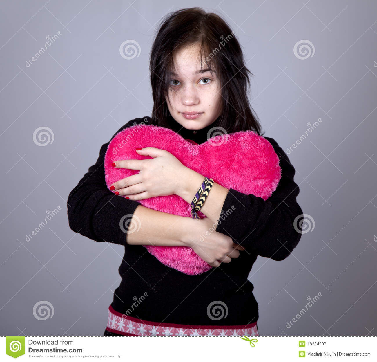 Gril Toy For Teenager : Funny girl with toy heart royalty free stock photography