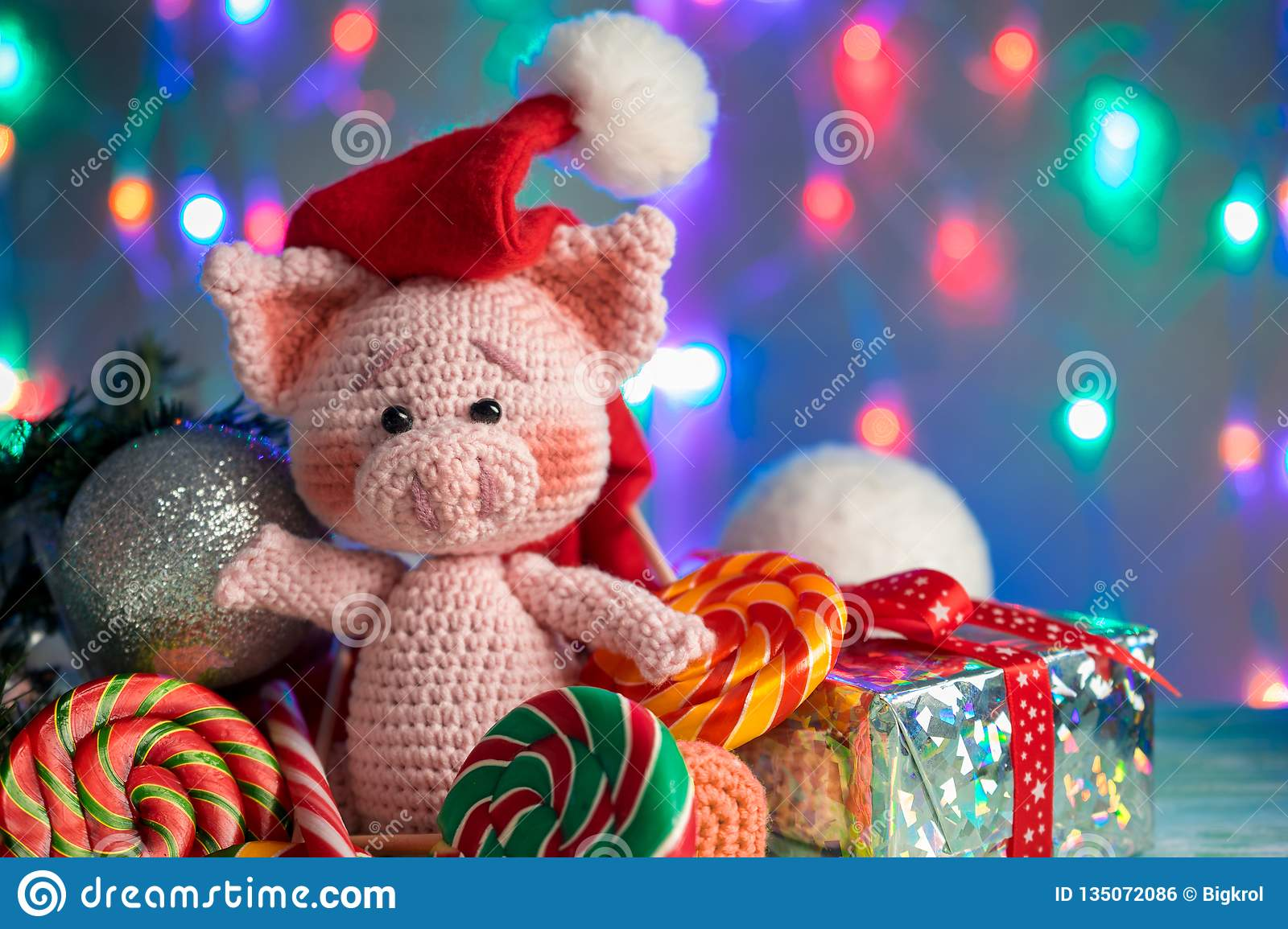 Funny greeting card with new year 2019. Pink pig with lollipops closeup on background with illumination