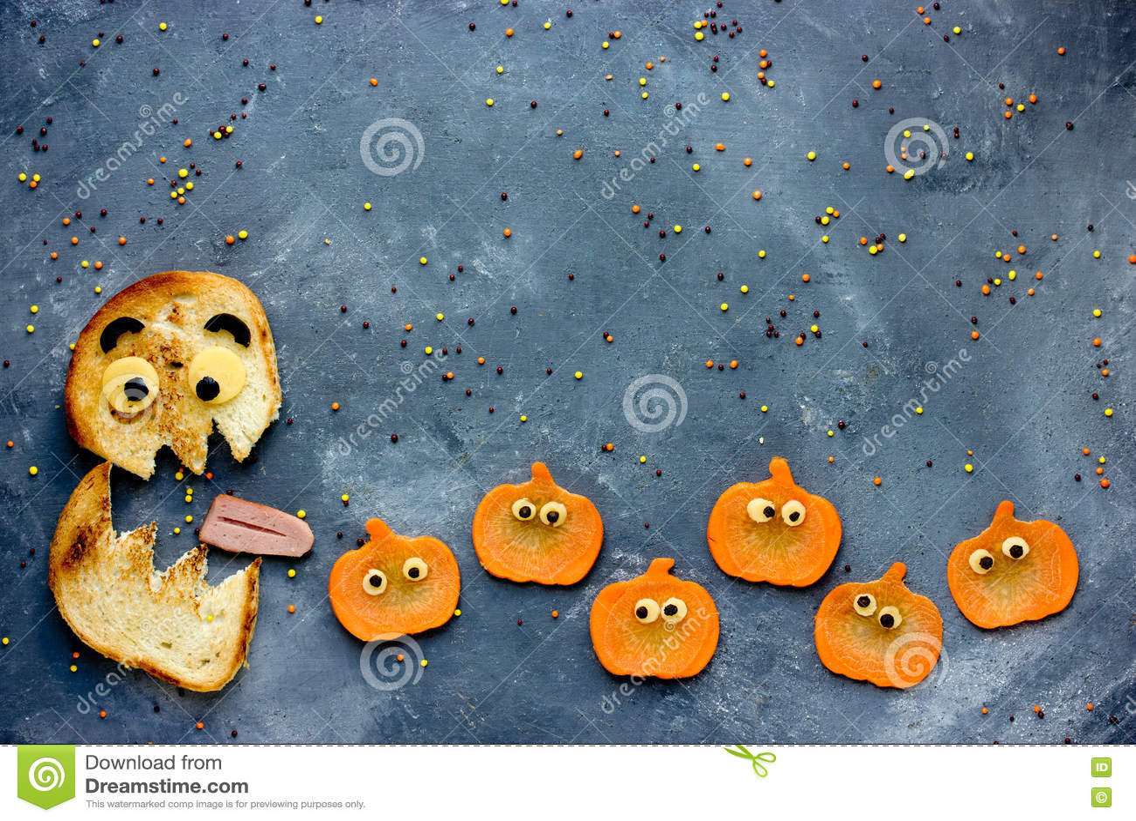 funny halloween food background bread monster eatsl pumpkin stock