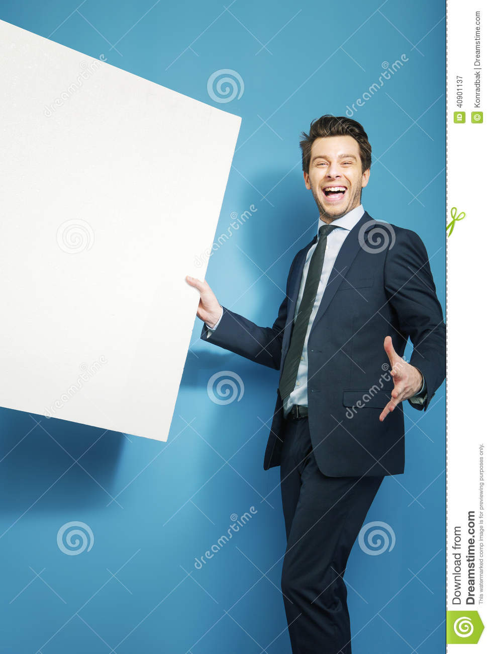 Funny handsome guy holding the board