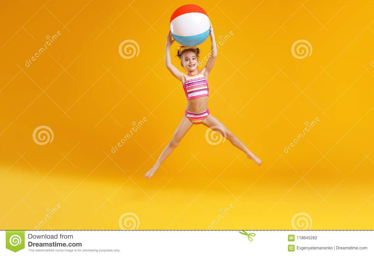 57a0a69e72 Funny Happy Child Jumping In Swimsuit On Colored Background Stock ...