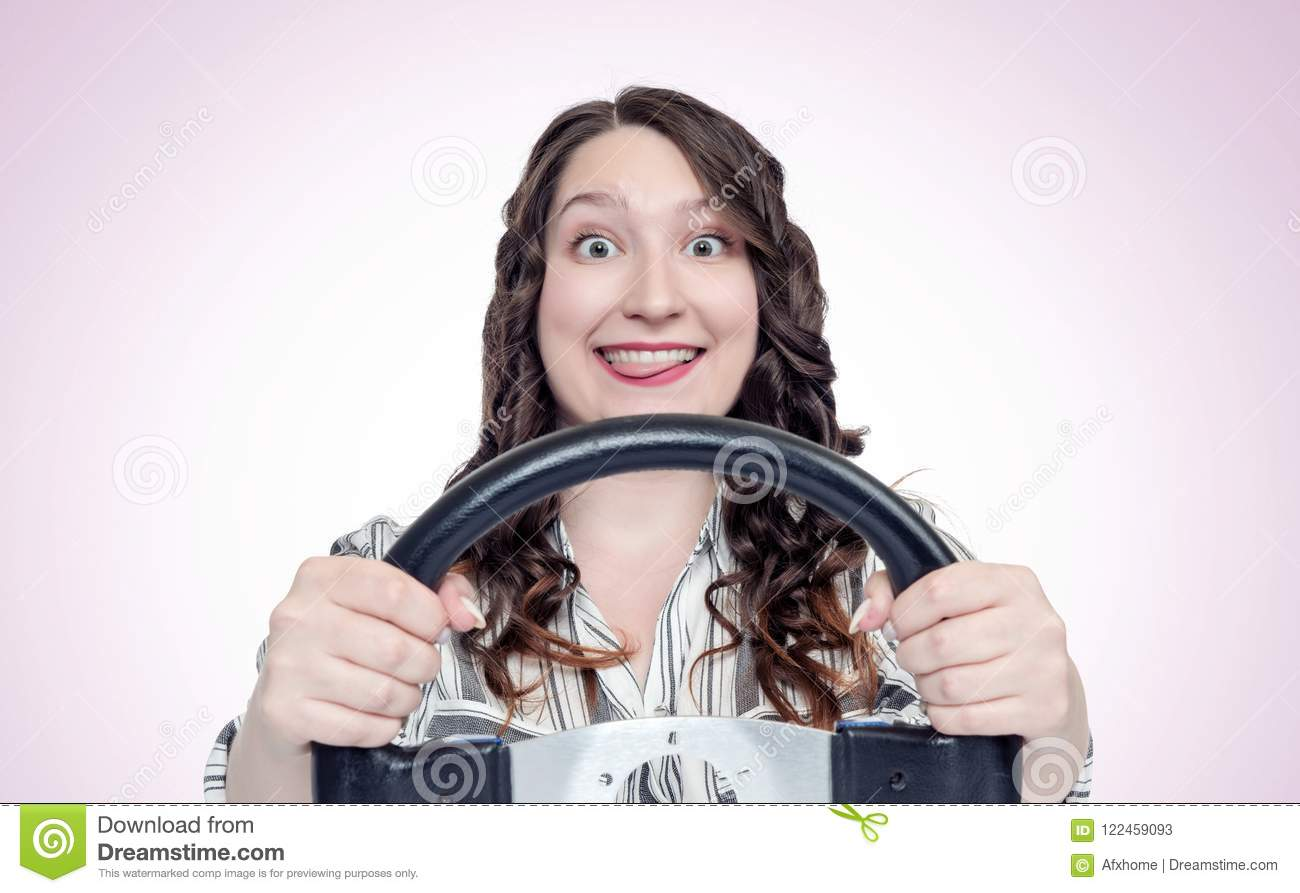 Funny happy emotions girl with car steering wheel, auto concept