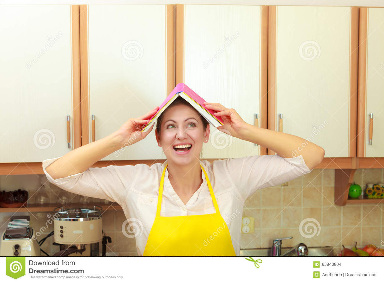 funny housewife with cookbook on head stock photo image of
