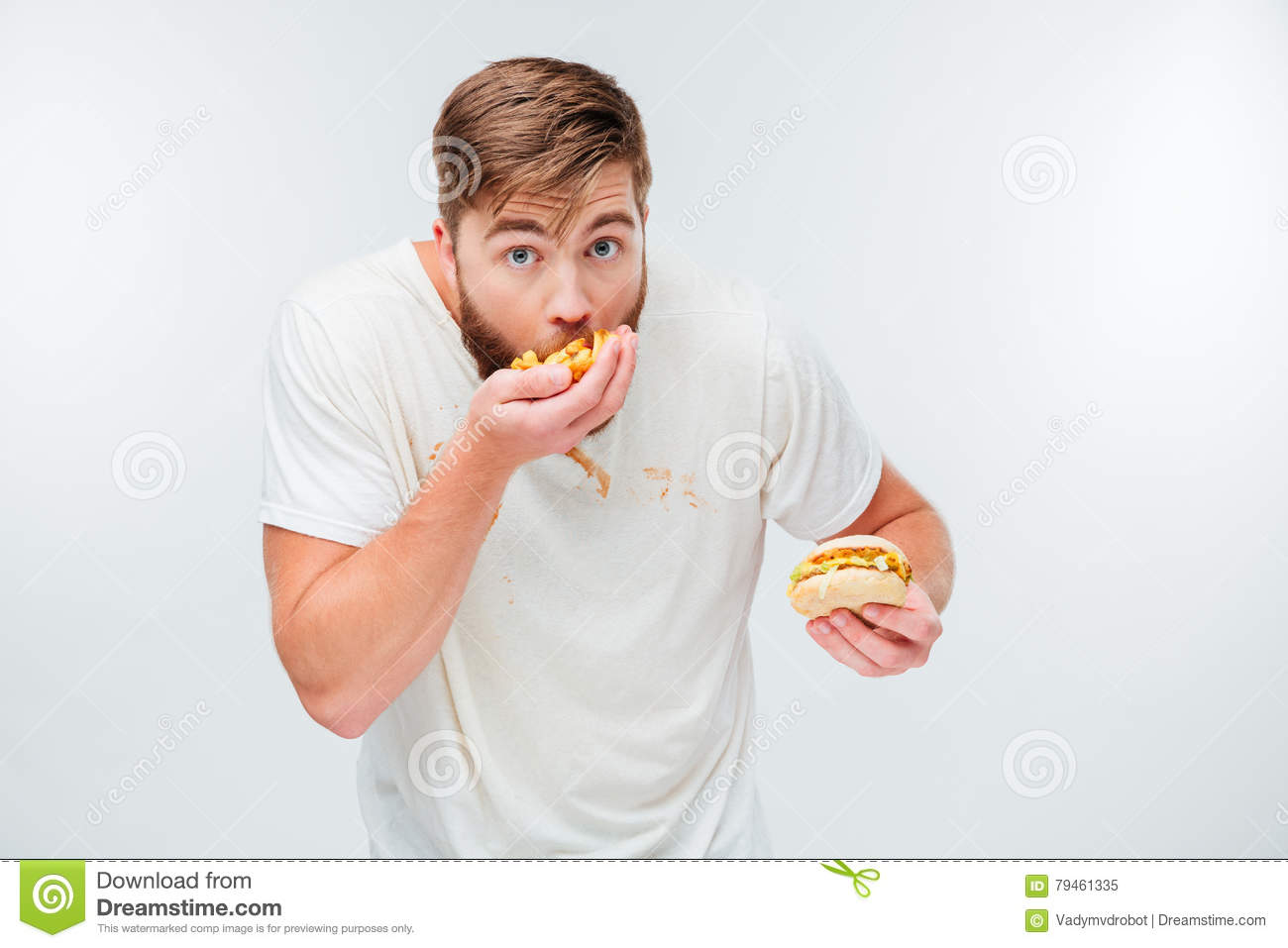Funny hungry bearded man eating junk food