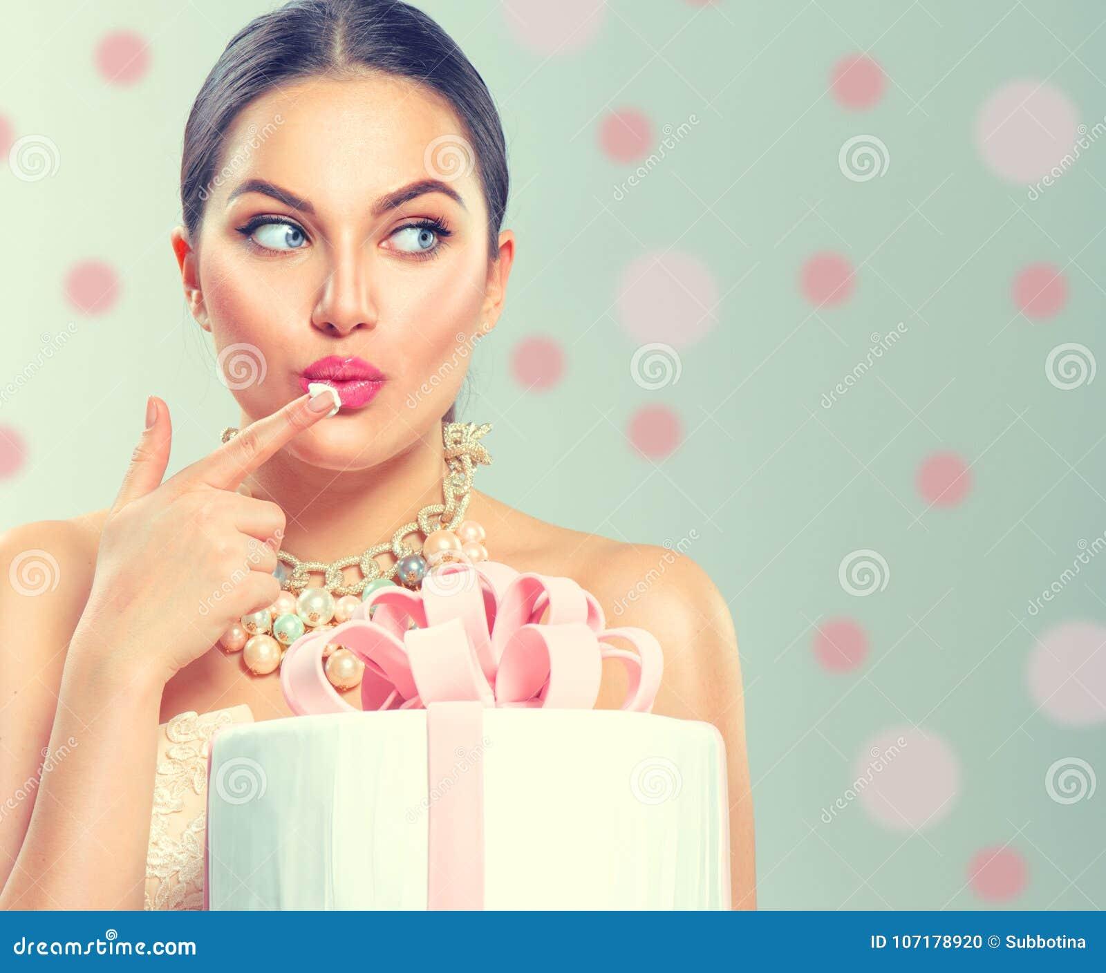Funny joyful beauty model girl holding big beautiful party or birthday cake