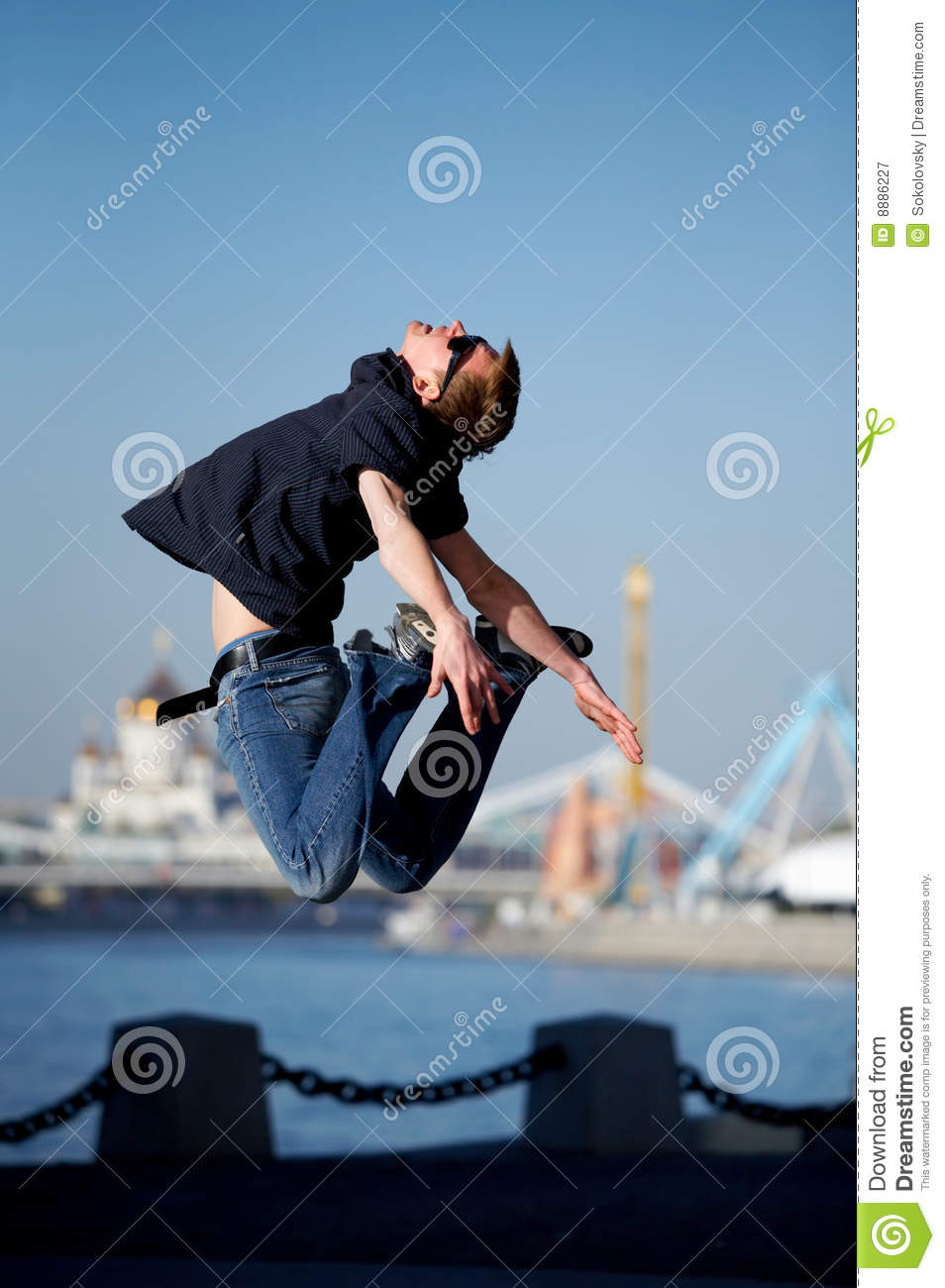 Funny Jumping Young Man Outdoors