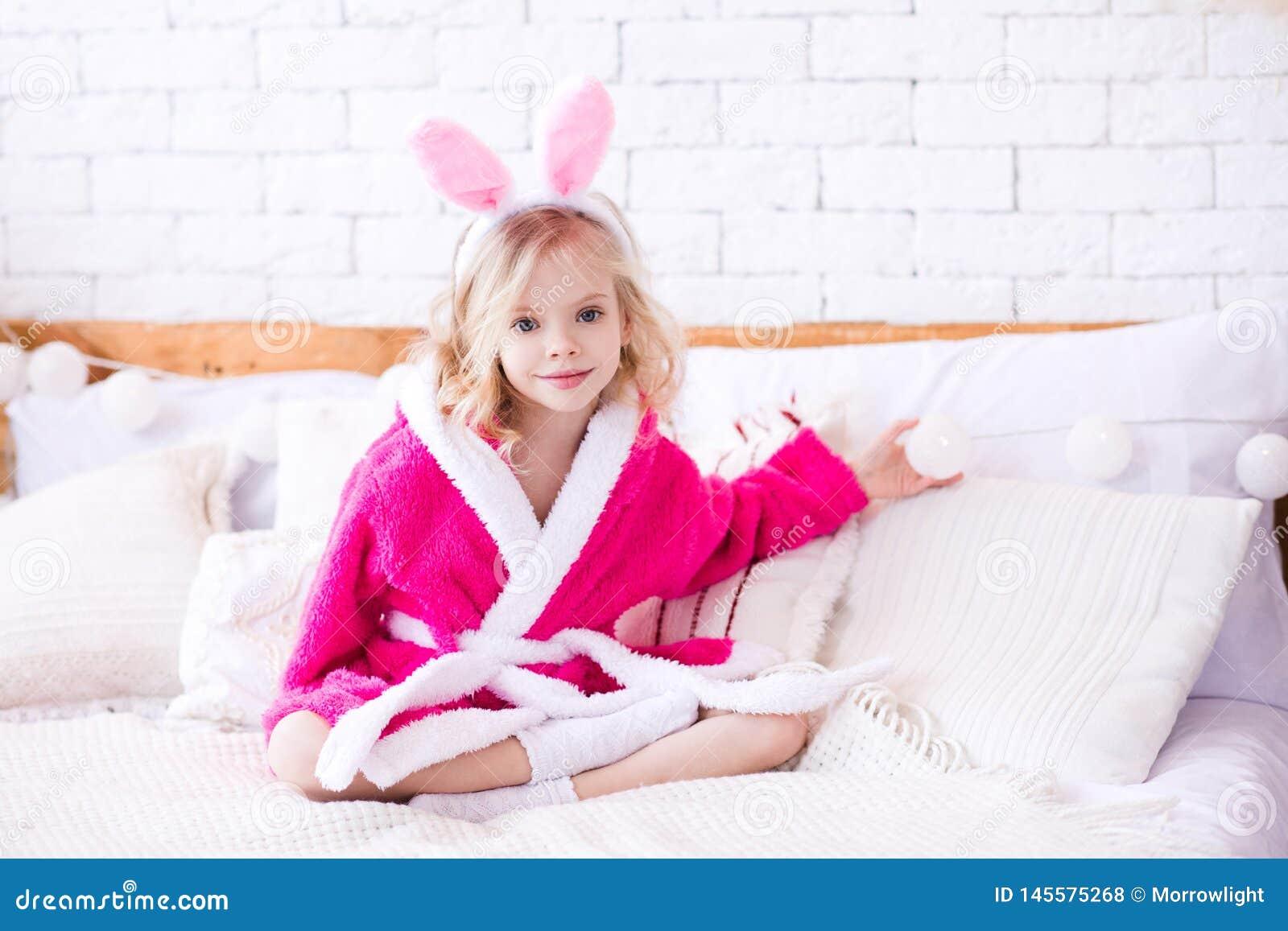 Funny kid girl in room