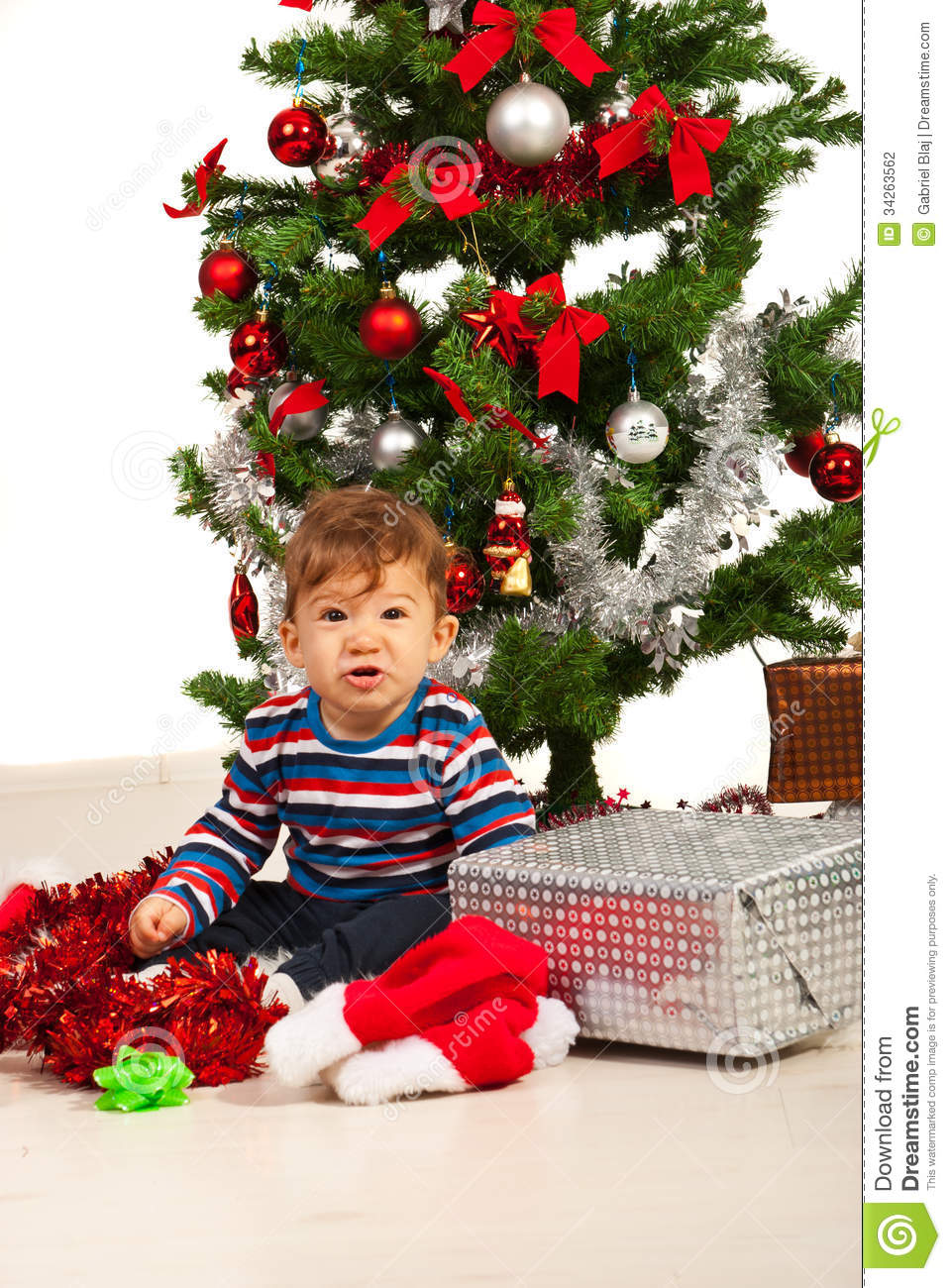 Funny Kid Under Christmas Tree Stock Photo - Image of look, looking ...